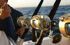 Deep sea saltwater fishing. Man holding lure while deep sea saltwater fishing royalty free stock photos