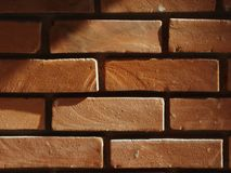 Brick wall illuminated by the sun royalty free stock images