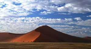Deep shadows on Sossusvlei dunes at sunrise, Namib desert Stock Photo
