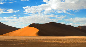 Deep shadows on Sossusvlei dunes at sunrise in Namib desert Stock Photography