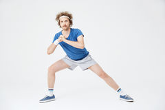 Deep side lunge position. Retro man in old style clothes Stock Image