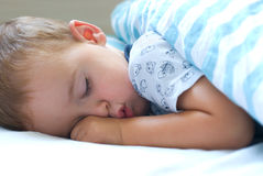 Deep sleep. Little boy sleeping with fist Royalty Free Stock Image