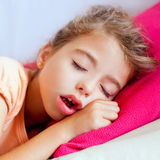 Deep sleeping children girl closeup portrait. On pink pillow stock image