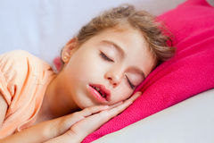 Deep sleeping children girl closeup portrait. On pink pillow royalty free stock photography