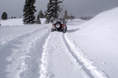 Deep snow 3. Four wheel drive leaves deep tracks in snow royalty free stock image