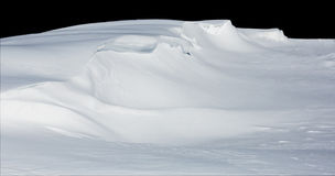 Deep snow drift isolated on black Stock Image