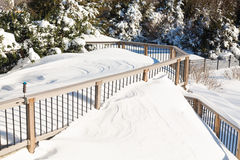 Deep snow in drifts on deck in back yard Stock Photos