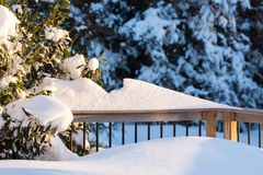 Deep snow in drifts on deck in back yard Royalty Free Stock Photos
