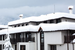 Deep snow on the roof of chalet Stock Photography