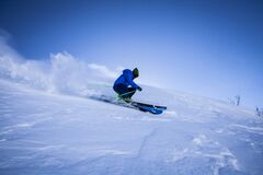 Deep snow skiing Stock Photos