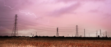 Deep South Thunderstorm Lightning Strike over Power Lines Poles Royalty Free Stock Photo