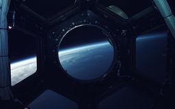 Deep space art. Awesome for wallpaper and print. Elements of this image furnished by NASA. Earth planet in space ship window porthole. Elements of this image Stock Images