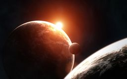 Deep space planets in the light of the rising red star. Elements of the image are furnished by NASA. Deep space planets in the light of the rising red star royalty free stock images