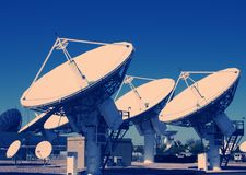 Deep Space Radio Frequency Telescopes. Cross Processed Royalty Free Stock Photo
