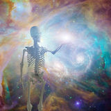 Deep space. Skeleton holds light in deep space Stock Photos