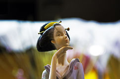 Deep in thought. Porcelain figurine of a geisha deep in thought Royalty Free Stock Photos