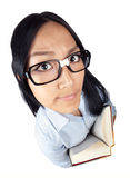 Deep in thought. A nerdy Asian girl holding a book that was shot with a wide angle lens Royalty Free Stock Images