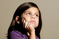 Deep thought. A little girl in deep thought Royalty Free Stock Photo