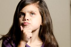 Deep thought. A little girl in deep thought Royalty Free Stock Photos