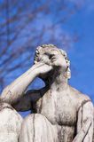 Deep in thought. Stone statue, man deep in thought stock photo