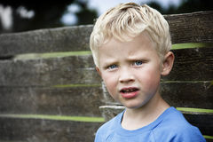 Deep thoughts. Lovely 5 year old boy in deep thoughts Royalty Free Stock Photo