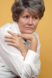 Deep thoughts. Introspective portrait of a lonely older woman Stock Photo