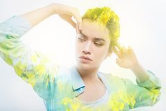 Smart student touching her forehead while thinking. Deep thoughts. Calm attentive responsible student being concentrated while standing with her fingers touching Stock Photography