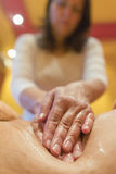 Deep tissue massage at a health and beauty spa. Woman having abdomen massage. Deep tissue massage at a health and beauty spa Royalty Free Stock Image