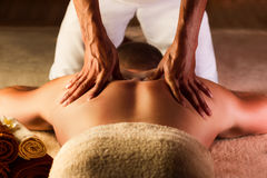 Deep tissue massage. The man has deep tissue massage on the back Royalty Free Stock Images
