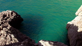 Deep turquoise water in a bay. Video clip stock footage