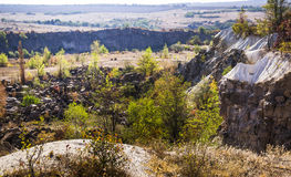 Deep unused stone quarry Royalty Free Stock Images