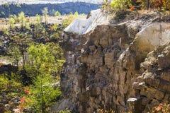 Deep unused stone quarry Stock Photo