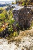 Deep unused stone quarry Stock Photography