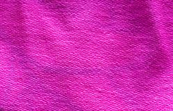 Deep vibrant pink colored cotton cloth fabric macro close up background. A Deep vibrant pink colored cotton cloth fabric macro close up background stock photography