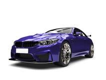 Deep violet modern super sports car - front view closeup shot Royalty Free Stock Photo