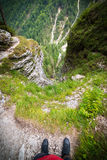 A man over deep void in Julian Alps in Slovenia. Deep void in Julian Alps in Slovenia - ultra wide photo Stock Photography