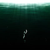 Deep water swim. Swimmer coming up from the deep Royalty Free Stock Images
