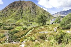 Remote Rural Irish Ruin in Mountains. Deep in the West Kerry countryside is the remote Black Valley, named as such as it was the last place in Ireland to get stock photography