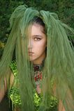Deep Wood's Fairy. Mysteriously saddened girl with a green veil covering her face Stock Image