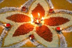 Deepak with colourful rangoli. Decoration with deep and rangoli on Diwali an Indian festival Royalty Free Stock Photos