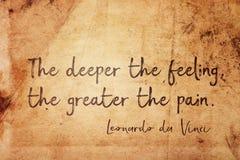 Deeper pain Leonardo. The deeper the feeling, the greater the pain - ancient Italian artist Leonardo da Vinci quote printed on vintage grunge paper Stock Image