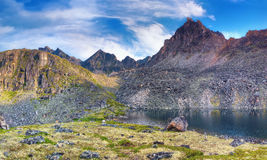 Deepest lake under the mountain peak. Eastern Siberia Royalty Free Stock Photo