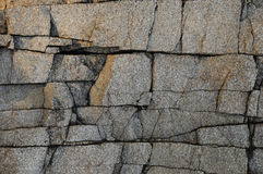Deeply cracked granite surface texture Royalty Free Stock Photo