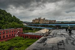 Deeply Overcast View of Abandoned Glass Factory & Hospital. A deeply overcast afternoon at the abandoned and now demolished Hazel-Atlas Glass Company looking Stock Images