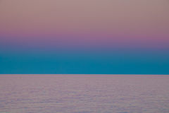 Deeply purple sunset over the sea Stock Photo