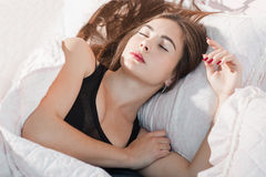 Deeply sleeping woman in morning portrait. Tired woman have rest after hard work day or crazy party. Drunk dream, sleeping pill, exhaustion, tiredness concept Stock Images