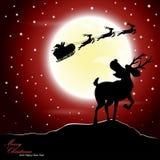 Deer afraid see Santa Claus riding a sleigh pulled by reindeer Royalty Free Stock Image