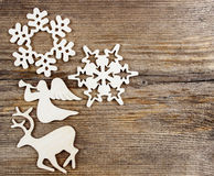 Deer, angel and snowflake shape made of wood Royalty Free Stock Photo