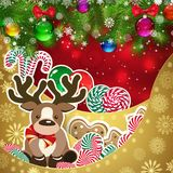 Deer on the background of sweets, decorated Christmas balls bran. Ches. Red background and gold layers, decorated with snowflake patterns. Christmas card Stock Images