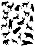 Deer and Bears. Black and white silhouettes of bear and deer royalty free illustration